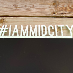 #iammidcity logo made of cut out wood